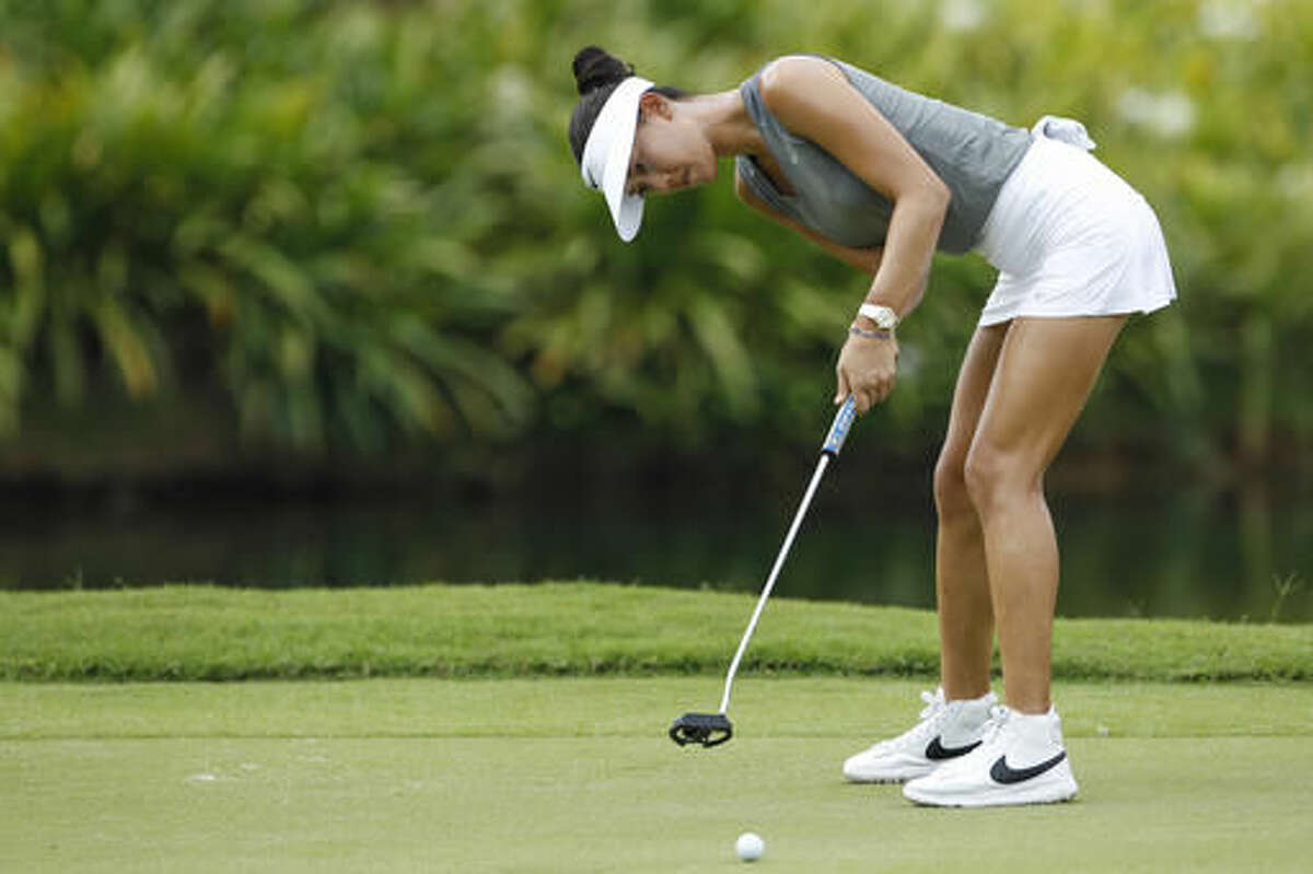 Michelle Wie of the United States putts on the sixth green during the second round of the LPGA golf tournament at Tournament Players Club (TPC) in Kuala Lumpur, Malaysia, Friday, Oct. 28, 2016. (AP Photo/Joshua Paul)