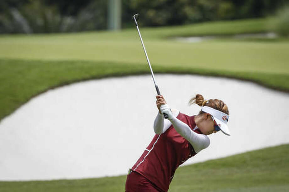 Jenny Shin of South Korea plays on the 11th hole during the second round of the LPGA golf tournament at Tournament Players Club in Kuala Lumpur, Malaysia, Friday, Oct. 28, 2016. (AP Photo/Joshua Paul)