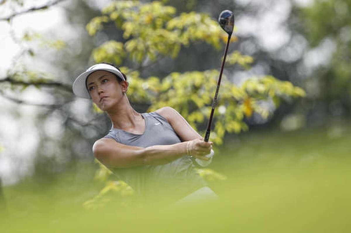Michelle Wie of the United States follows her shot on the third hole during the second round of the LPGA golf tournament at Tournament Players Club (TPC) in Kuala Lumpur, Malaysia, Friday, Oct. 28, 2016. (AP Photo/Joshua Paul)