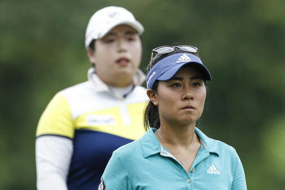Danielle Kang, right, of the United States and Shanshan Feng of China approach the 11th green during the second round of the LPGA golf tournament at Tournament Players Club in Kuala Lumpur, Malaysia, Friday, Oct. 28, 2016. (AP Photo/Joshua Paul)