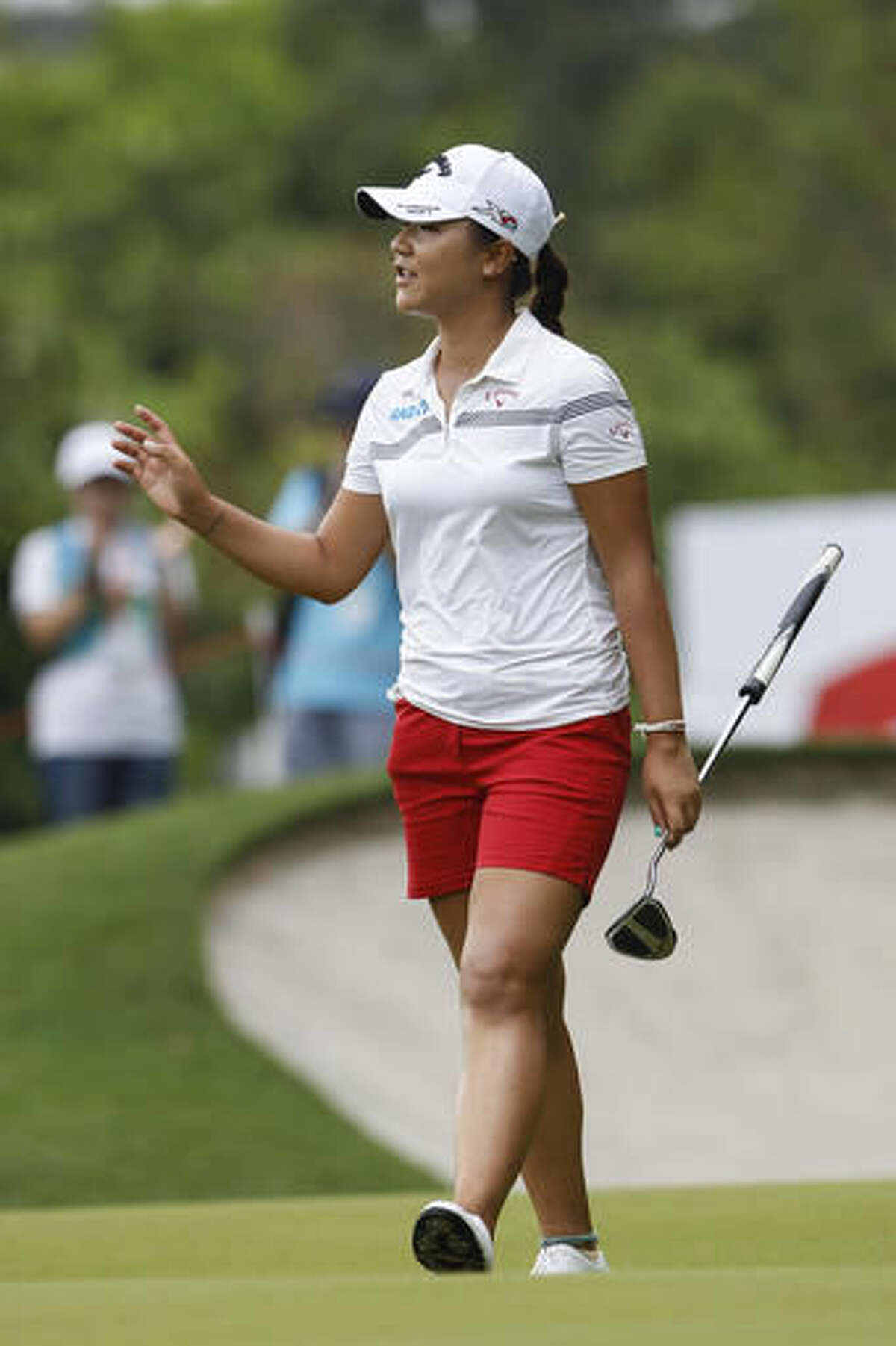 Lydia Ko of New Zealand acknowledges the crowd after putting on the eleventh green during the second round of the LPGA golf tournament at Tournament Players Club (TPC) in Kuala Lumpur, Malaysia, Friday, Oct. 28, 2016. (AP Photo/Joshua Paul)