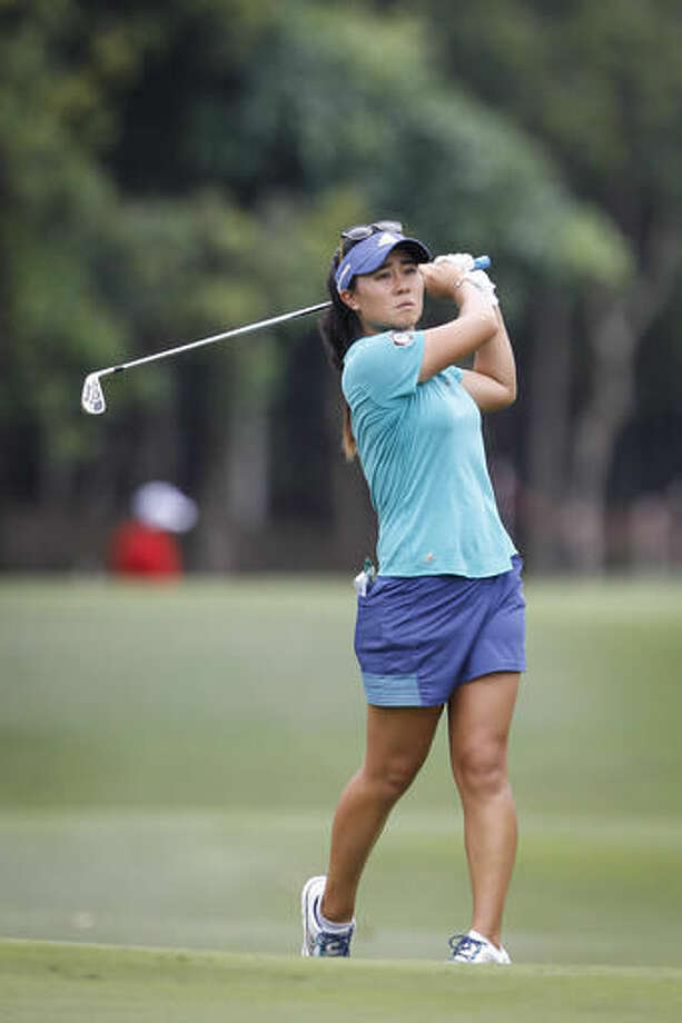 Danielle Kang of the United States follows her shot on the 11th hole during the second round of the LPGA golf tournament at Tournament Players Club in Kuala Lumpur, Malaysia, Friday, Oct. 28, 2016. (AP Photo/Joshua Paul)