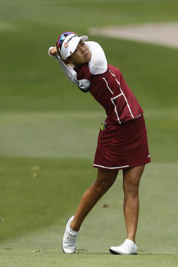 Jenny Shin of South Korea follows her shot on the 11th hole during the second round of the LPGA golf tournament at Tournament Players Club in Kuala Lumpur, Malaysia, Friday, Oct. 28, 2016. (AP Photo/Joshua Paul)