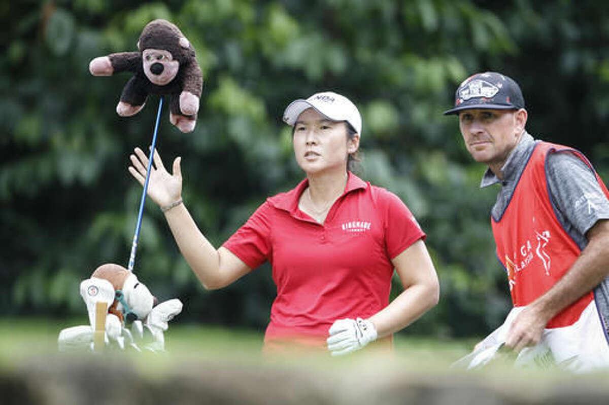 Candie Kung of Taiwan prepares to tee off on the 14th hole during the second round of the LPGA golf tournament at Tournament Players Club in Kuala Lumpur, Malaysia, Friday, Oct. 28, 2016. (AP Photo/Joshua Paul)