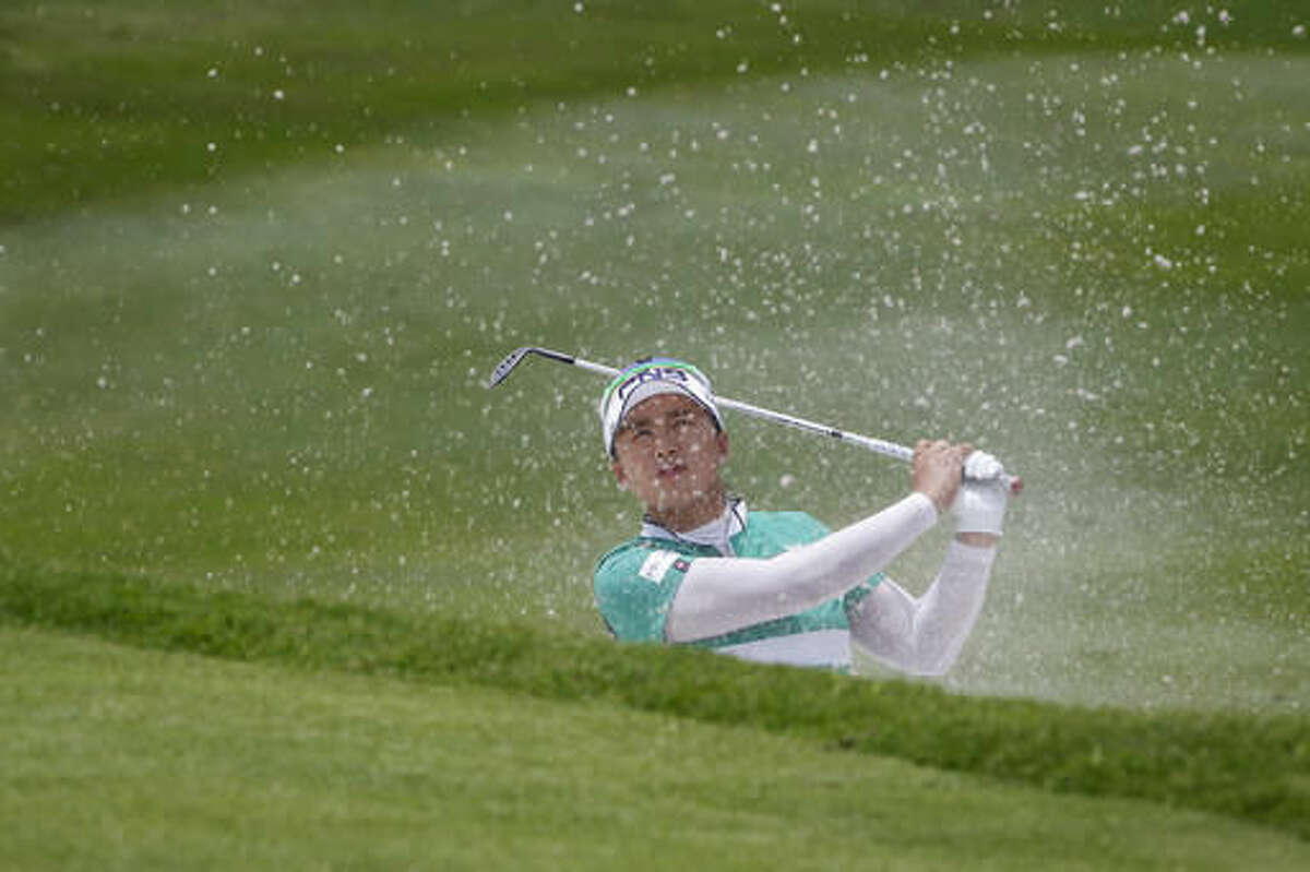 Amy Yang of South Korea plays out of a bunker on the 11th hole during the second round of the LPGA golf tournament at Tournament Players Club in Kuala Lumpur, Malaysia, Friday, Oct. 28, 2016. (AP Photo/Joshua Paul)