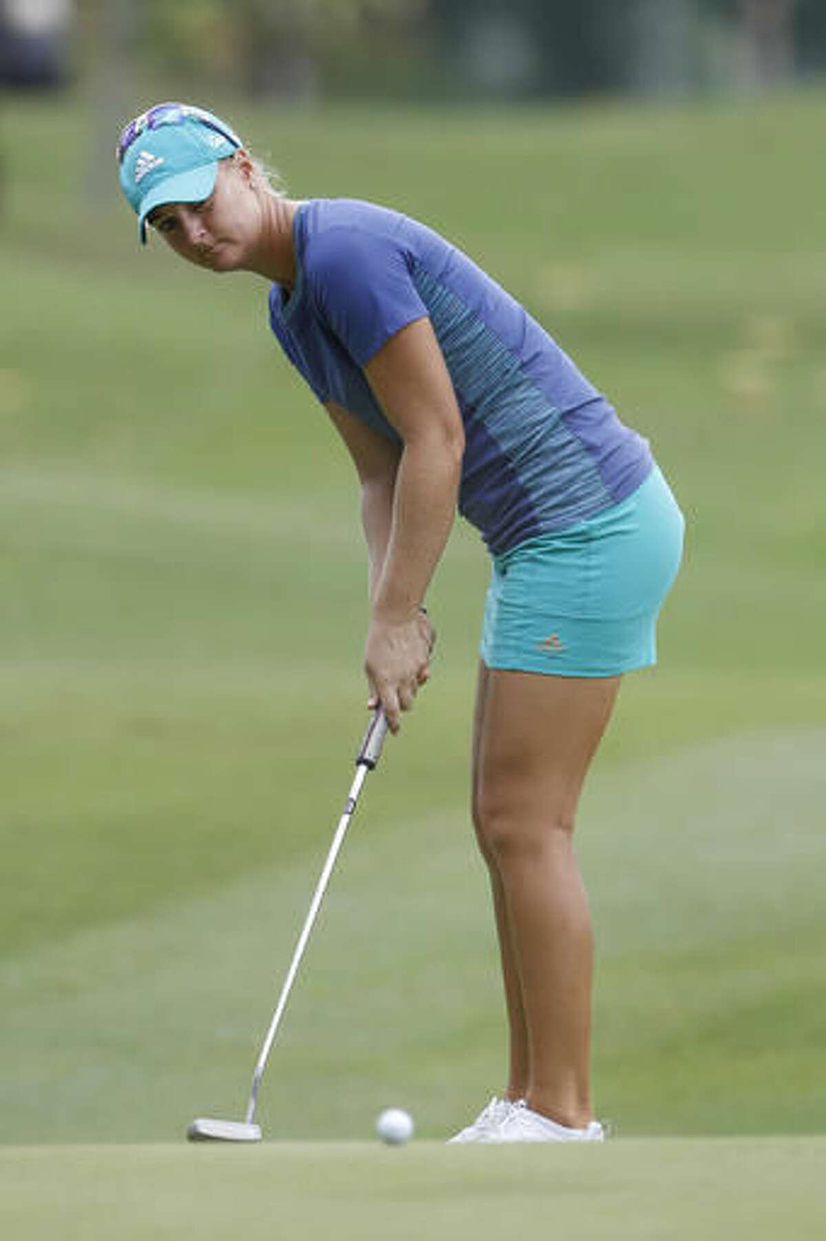 Anna Nordqvist of Sweden putts on the seventh green during the second round of the LPGA golf tournament at Tournament Players Club in Kuala Lumpur, Malaysia, Friday, Oct. 28, 2016. (AP Photo/Joshua Paul)