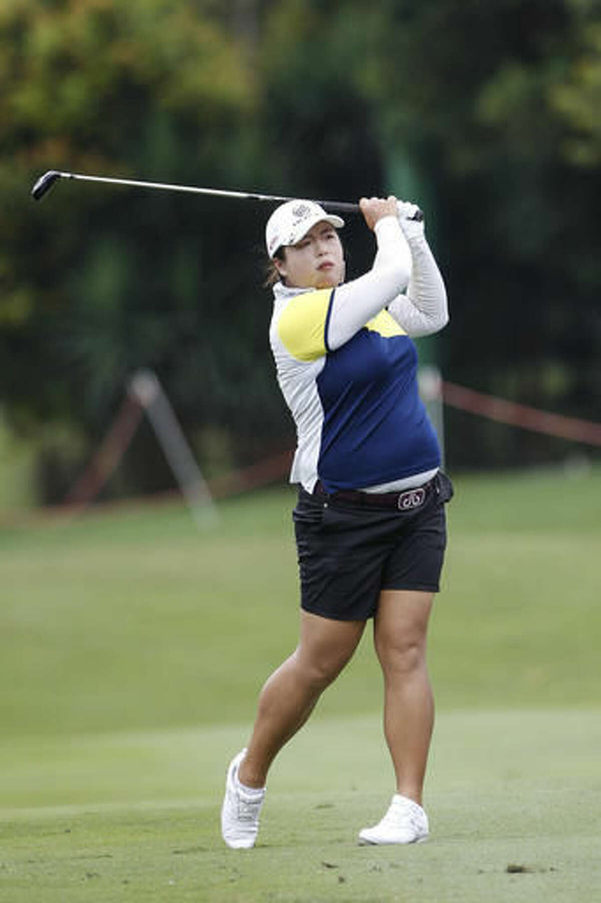 Shanshan Feng of China follows her shot on the 11th hole during the second round of the LPGA golf tournament at Tournament Players Club in Kuala Lumpur, Malaysia, Friday, Oct. 28, 2016. (AP Photo/Joshua Paul)