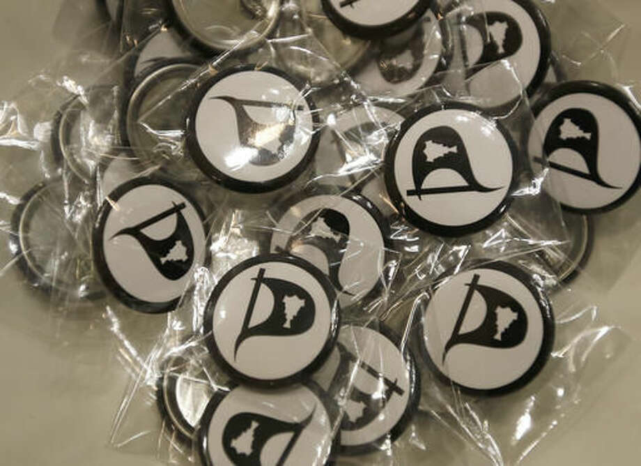 Pirate party pin badges ready for distribution to the public during an advertising event for the upcoming Iceland Parliamentary Elections at a shopping mall in Reykjavik, Wednesday, Oct. 26, 2016. According to polls the Piratar (Pirate) Party, an anti-authoritarian band of buccaneers that wants to shift power from government to people, is one of the front-runners in the Oct. 29, election triggered by financial scandal in a country still recovering from economic catastrophe. (AP Photo/Frank Augstein)