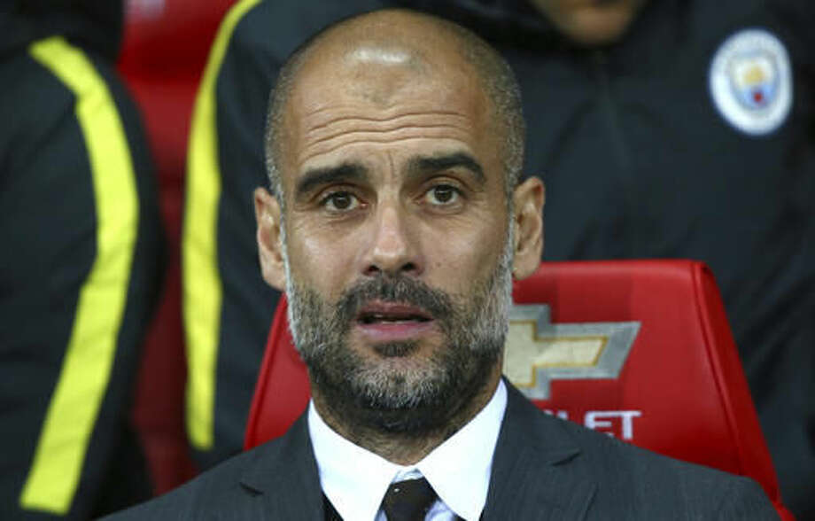 Manchester City's manager Pep Guardiola ahead of the English League Cup soccer match between Manchester United and Manchester City at Old Trafford stadium in Manchester, England, Wednesday, Oct. 26, 2016. (AP Photo/Dave Thompson)