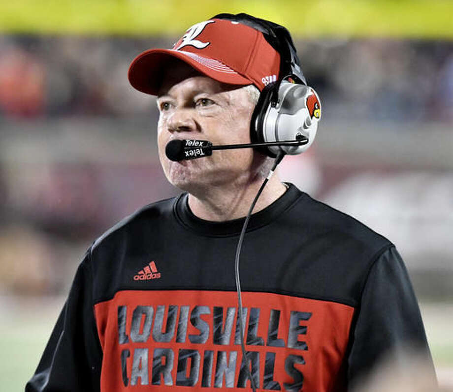 FILE - In this Oct. 14, 2016, file photo, Louisville head coach Bobby Petrino watches his team during the second half of an NCAA college football game against Duke in Louisville, Ky. Louisville and Virginia are heading in opposite directions but have taken basically the same approach in their preparations before Saturday's matchup. (AP Photo/Timothy D. Easley, File)