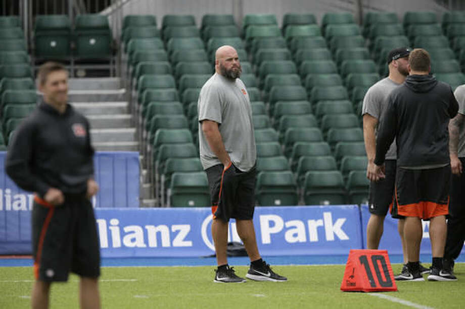 Cincinnati Bengals offensive tackle Andrew Whitworth, centre, takes part in a practice session at Allianz Park in London, England, Friday Oct. 28, 2016. The Washington Redskins are due to play the Cincinnati Bengals at Wembley Stadium in London on Sunday in a regular season NFL game. (AP Photo/Tim Ireland)