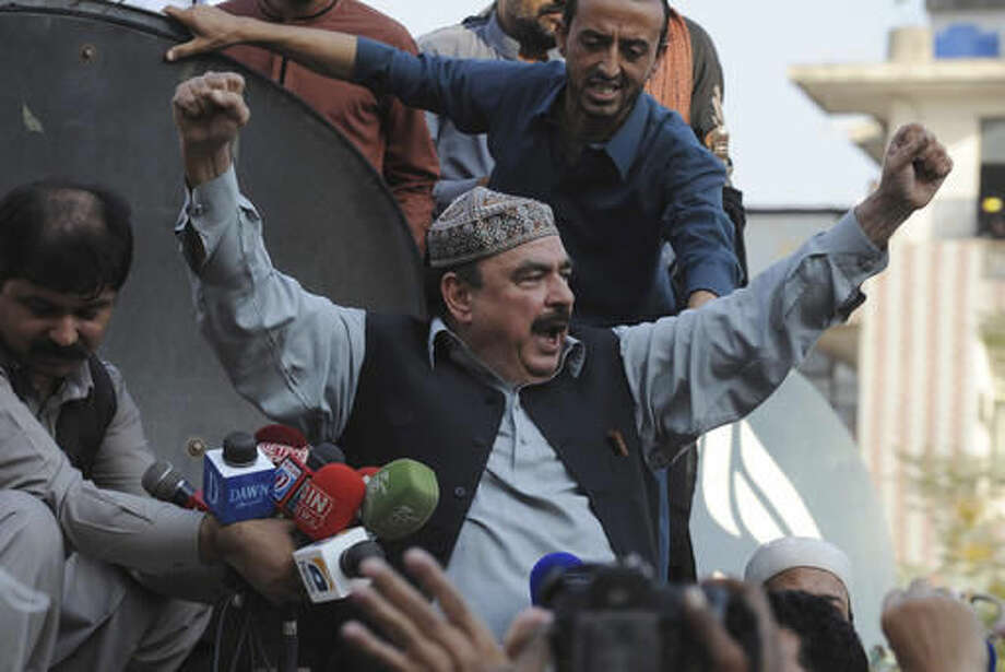 Pakistan's opposition leader Shiekh Rashid addresses anti government protesters in Rawalpindi, Pakistan, Friday, Oct. 28, 2016. Pakistani police have charged with batons and fired tear gas at stone-throwing supporters of cricketer-turned-politician Imran Khan who are rallying in Islamabad in defiance of a government-imposed ban on demonstrations. (AP Photo/B.K. Bangash)