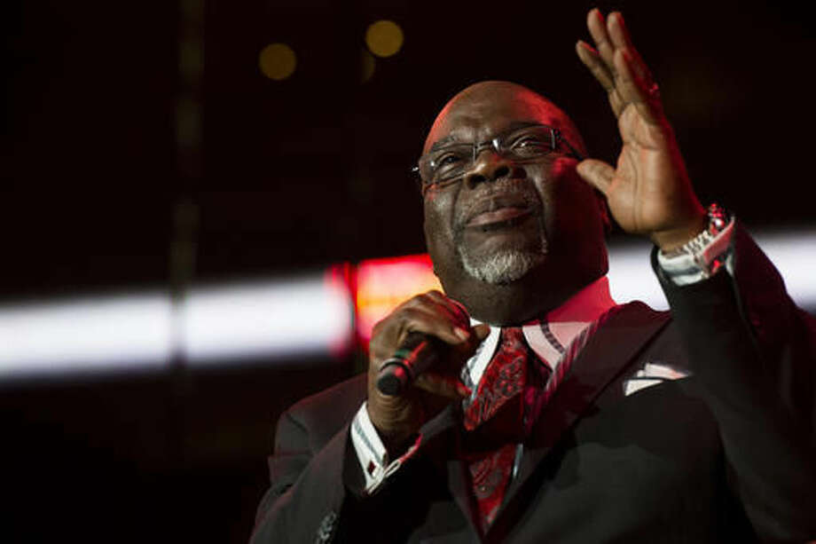FILE - In this Saturday, May 11, 2013, file photo, Bishop T.D. Jakes speaks during McDonald's Gospelfest 2013 at the Prudential Center, in Newark, N.J. Jakes' new show isn't about bible verses, but he still hopes his new OWN talk show will minister to a nation in turmoil. (Photo by Charles Sykes/Invision/AP, File)