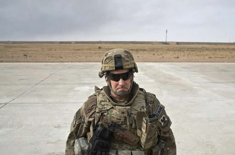 """Col. Rhett Champagne, the commander of the U.S. Air Force 821st Contingency Response Group, stands on the airstrip a coalition air base in Qayara, some 50 kilometers south of Mosul, Iraq, Friday, Oct. 28, 2016. The U.S. military says Iraqi forces have retaken 40 villages from the Islamic State group near Mosul since a massive operation to drive the militants from the city began last week. It says Iraqi troops are consolidating gains made east and south of the city earlier this week, but insisted """"momentum"""" was still on their side. (AP Photo/Marko Drobnjakovic)"""