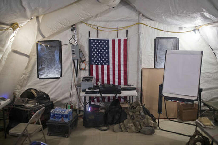 """A U.S. flag hangs on the wall of a command and control center at a coalition air base in Qayara, some 50 kilometers south of Mosul, Iraq, Friday, Oct. 28, 2016. The U.S. military says Iraqi forces have retaken 40 villages from the Islamic State group near Mosul since a massive operation to drive the militants from the city began last week. It says Iraqi troops are consolidating gains made east and south of the city earlier this week, but insisted """"momentum"""" was still on their side. (AP Photo/Marko Drobnjakovic)"""