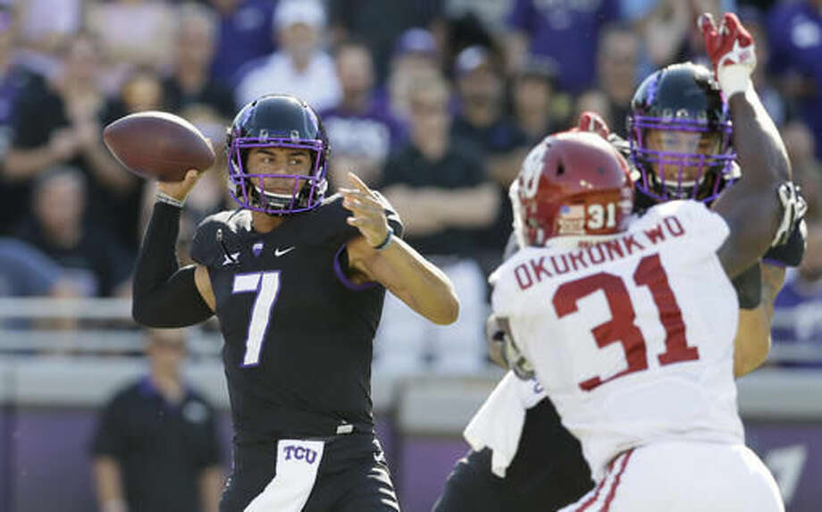 FILE - In this Saturday, Oct. 1, 2016 file photo, TCU quarterback Kenny Hill (7) passes as Garrett Altman blocks Oklahoma linebacker Ogbonnia Okoronkwo (31) during the first quarter of an NCAA college football game in Fort Worth, Texas. Patrick Mahomes, Kenny Hill and Shane Buechele are Big 12 starting quarterback with something else in common, they are the sons of former Major League Baseball players. (AP Photo/LM Otero, File)