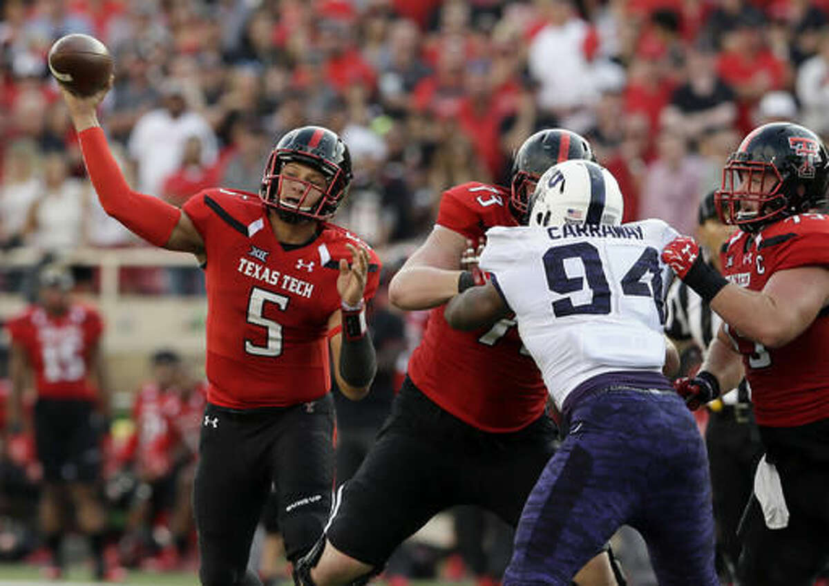 FILE - In this Sept. 26, 2015, file photo, Texas Tech quarterback Patrick Mahomes (5) passes under pressure during the second half of an NCAA college football game against TCU in Lubbock, Texas. Texas Tech takes a three-game losing streak into Saturday's game at TCU, which has won the last two games in the series with some big numbers of its own. (AP Photo/LM Otero, File)
