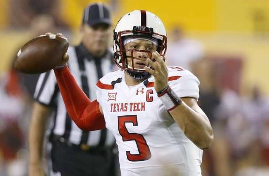 FILE - In this Sept. 10, 2016, file photo, Texas Tech's Patrick Mahomes looks to pass against Arizona State during the first half of an NCAA college football game, in Tempe, Ariz. Patrick Mahomes, Kenny Hill and Shane Buechele are Big 12 starting quarterback with something else in common, they are the sons of former Major League Baseball players. (AP Photo/Ross D. Franklin, File)