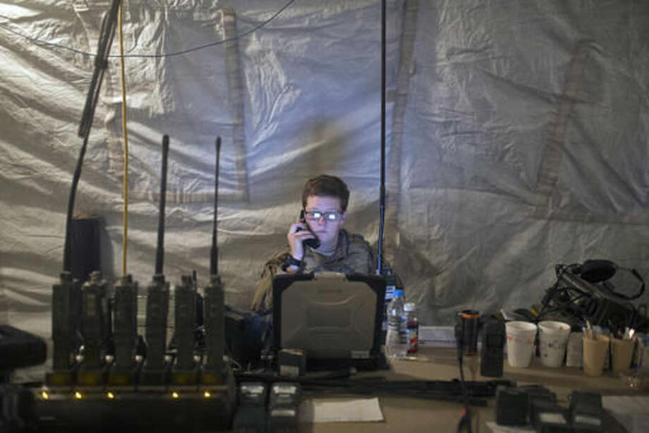"""A U.S. Air Force service member uses radio communication at the command and control center inside a coalition air base in Qayara, some 50 kilometers south of Mosul, Iraq, Friday, Oct. 28, 2016. The U.S. military says Iraqi forces have retaken 40 villages from the Islamic State group near Mosul since a massive operation to drive the militants from the city began last week. It says Iraqi troops are consolidating gains made east and south of the city earlier this week, but insisted """"momentum"""" was still on their side. (AP Photo/Marko Drobnjakovic)"""