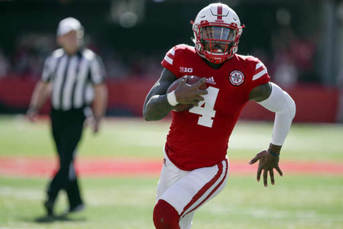 FILE - In this Saturday, Oct. 22, 2016, file photo, Nebraska quarterback Tommy Armstrong Jr. (4) carries the ball during the first half of an NCAA college football game against Purdue in Lincoln, Neb. Seventh-ranked Nebraska has a chance to silence its critics with a trip to No. 11 Wisconsin on Saturday night in a pivotal Big Ten West Division matchup. (AP Photo/Nati Harnik, File)