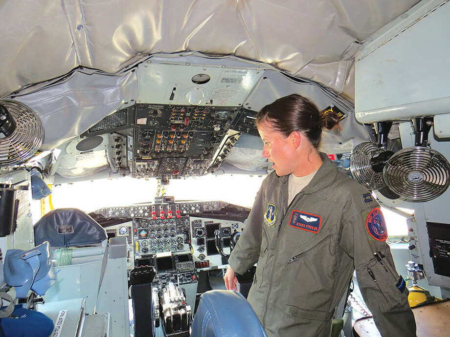 Captain Jessica Streiler gives a tour of the cockpit of the KC-135 during media day at Scott Air Force Base.