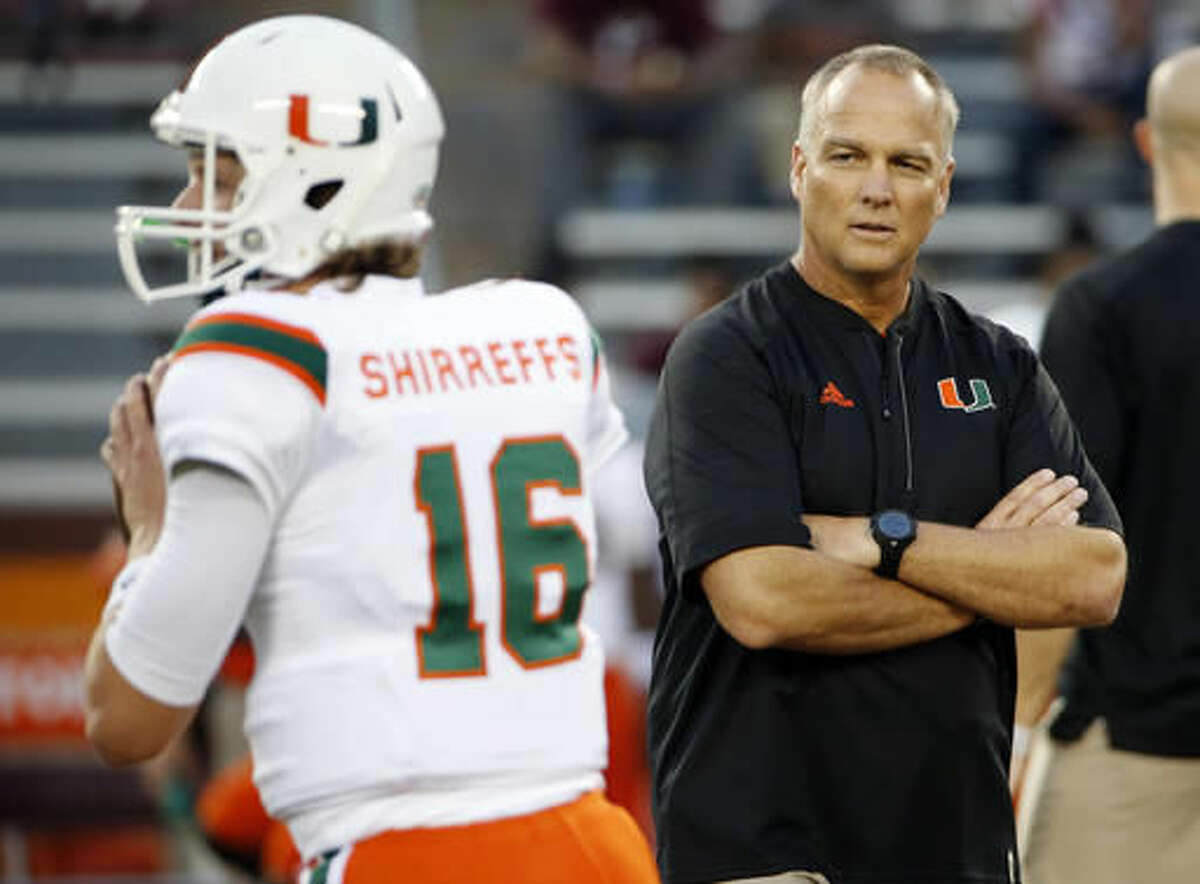 FILE - In this Thursday, Oct. 20, 2016, file photo, Miami head coach Mark Richt watches warm ups before an NCAA college football game against Virginia Tech at Lane stadium in Blacksburg, Va., Miami and Notre Dame can only wish their game Saturday could come close to living up to the intensity the series had nearly three decades ago when for three straight seasons the winner was the national champion. (AP Photo/Steve Helber, File)