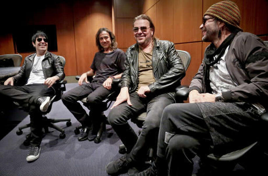 Members of the Mexican rock band Maná, drummer Alex González, from left, bassist Juan Calleros, vocalist Fher Olvera and guitarist Sergio Vallín appear during an interview, Tuesday Oct. 25, 2016, in New York. (AP Photo/Bebeto Matthews)