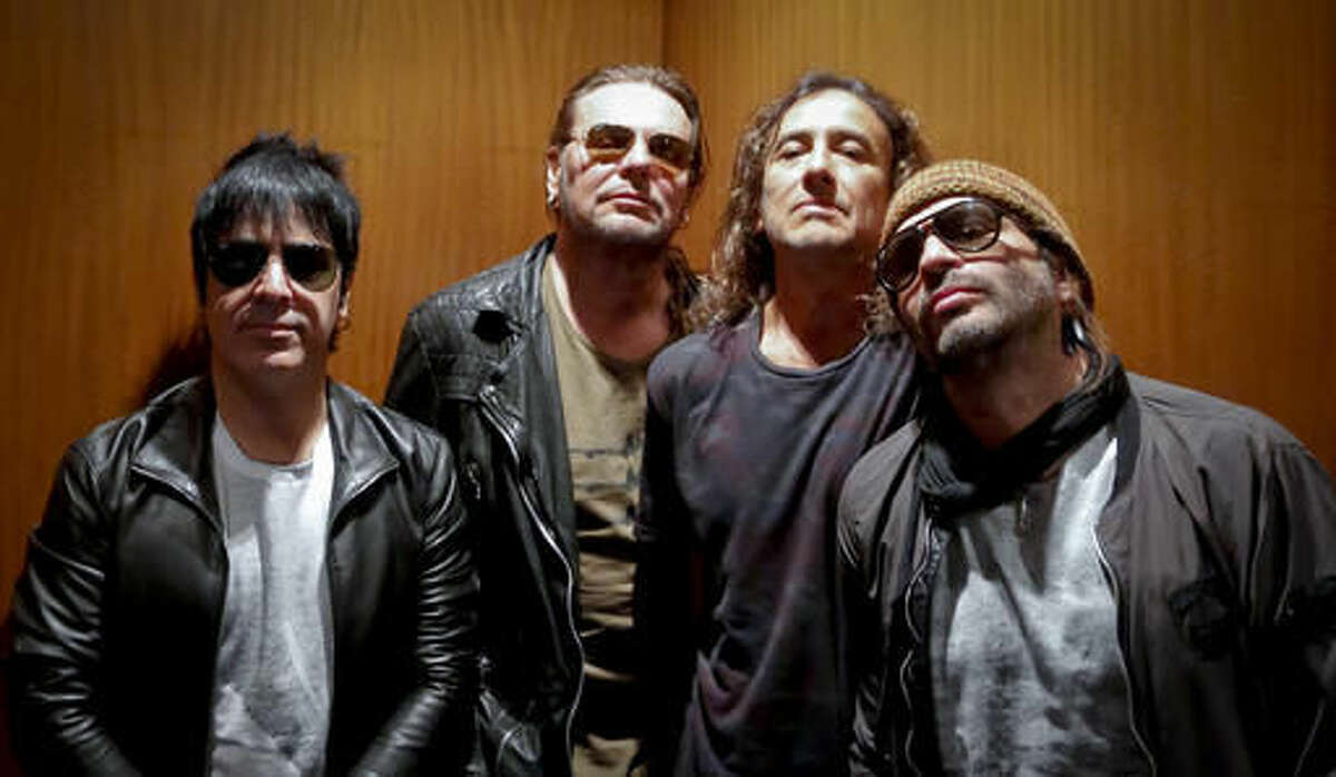 FILE - In this Oct. 25, 2016 file photo, members of the Mexican rock band Maná, drummer Alex González, from left, vocalist Fher Olvera, bassist Juan Calleros and guitarist Sergio Vallín pose during an interview in New York. The iconic band, known for its environmental activism, is stepping into the fashion industry with Ritos del Sol, an ecofriendly brand of jeans and T-Shirts for men and women, available in the US and online. Each item sold would save a sea turtle in the coast of Mexico, according to vocalist Fher. (AP Photo/Bebeto Matthews)