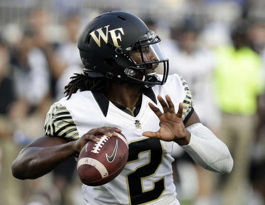 FILE - In this Saturday, Sept. 10, 2016, file photo, Wake Forest quarterback Kendall Hinton (2) passes against Duke during the second half of an NCAA college football game in Durham, N.C. Hinton has missed four straight games with a knee injury and it's unclear whether he'll be ready to play against Army on Saturday. (AP Photo/Gerry Broome, File)