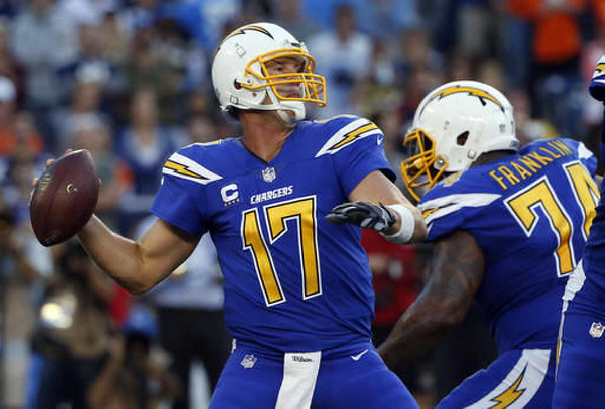 FILE - In this Thursday, Oct. 13, 2016, file photo, San Diego Chargers quarterback Philip Rivers throws a pass during the first half of an NFL football game against the Denver Broncos, in San Diego. Quick turnaround: San Diego and Denver meet up for the second time in 18 days. And how times have changed. The once-staggering Chargers are now full of swagger as they try to get back into the thick of the tight AFC West race. And the Broncos have their coach back and their QB is healthy. (AP Photo/Lenny Ignelzi, File)