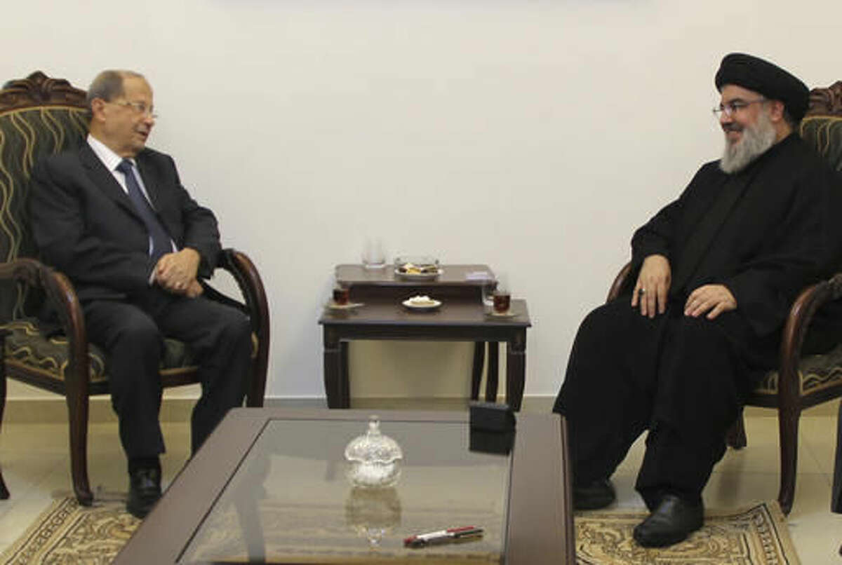 In this picture taken on Sunday Oct. 23, 2016, provided by Hezbollah media relations office, Hezbollah leader Sayyed Hassan Nasrallah, right, meets with Christian leader Michel Aoun, left, in Beirut, Lebanon. Michel Aoun, an 81-year-old veteran Christian leader, is set to be elected by Parliament on Monday as part of a political deal that's expected to be another boost for President Bashar Assad in neighboring Syria. (Hezbollah Media Relations Office, via AP )