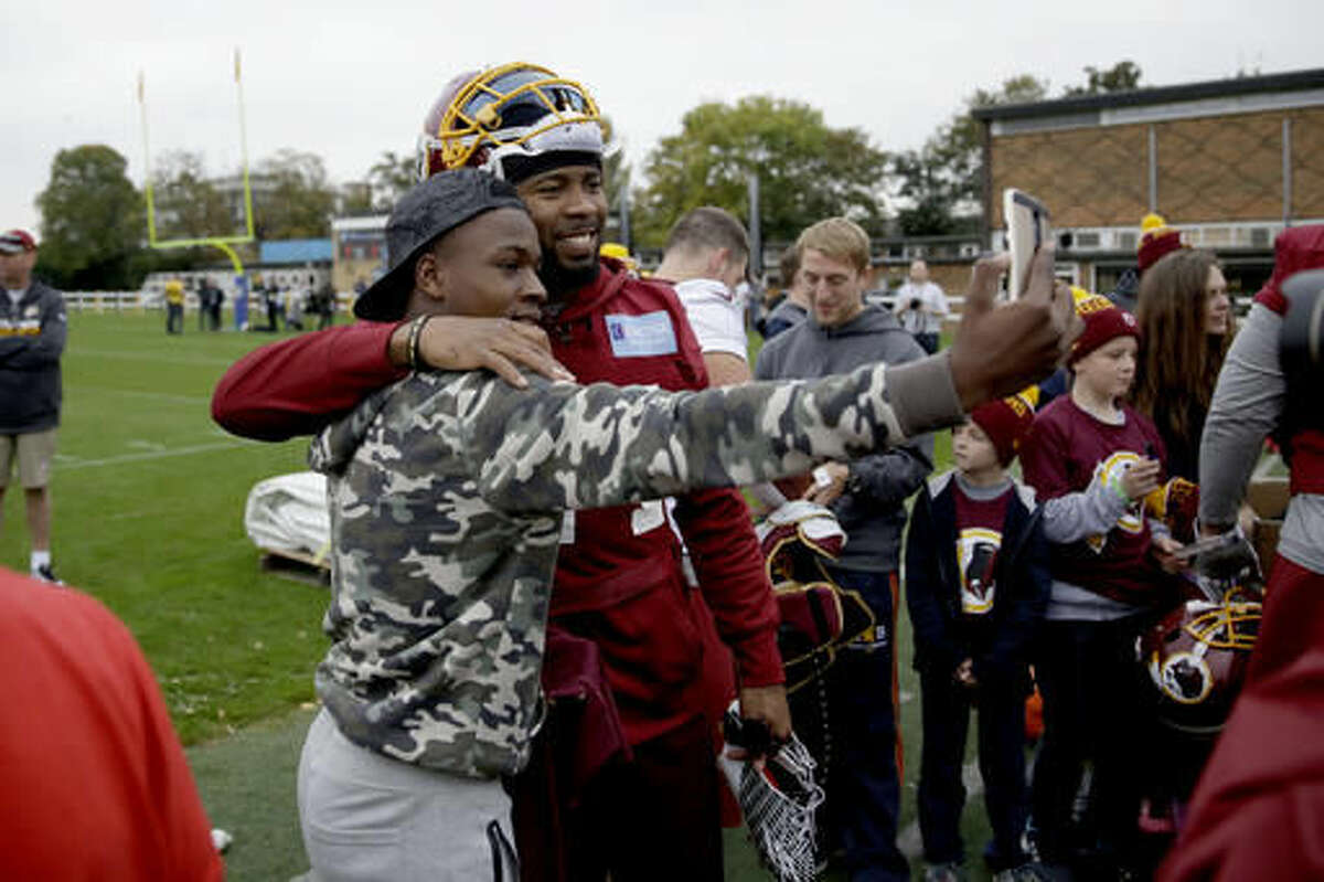 Washington Redskins cornerback Josh Norman, who is recovering from a concussion, poses for a photograph after a training session at Wasps rugby union team training ground in west London, Friday, Oct. 28, 2016. The Washington Redskins are due to play the Cincinnati Bengals at Wembley stadium in London on Sunday in a regular season NFL game. (AP Photo/Matt Dunham)