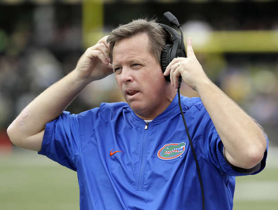 FILE - In this Oct. 1, 2016, file photo, Florida head coach Jim McElwain watches from the sideline in the second half of an NCAA college football game against Vanderbilt in Nashville, Tenn. Georgia head coach Kirby Smart and McElwain become close friends while spending four years together at Alabama (2008-11) and will reunite for a game Saturday, Oct. 29, 2016. (AP Photo/Mark Humphrey, File)