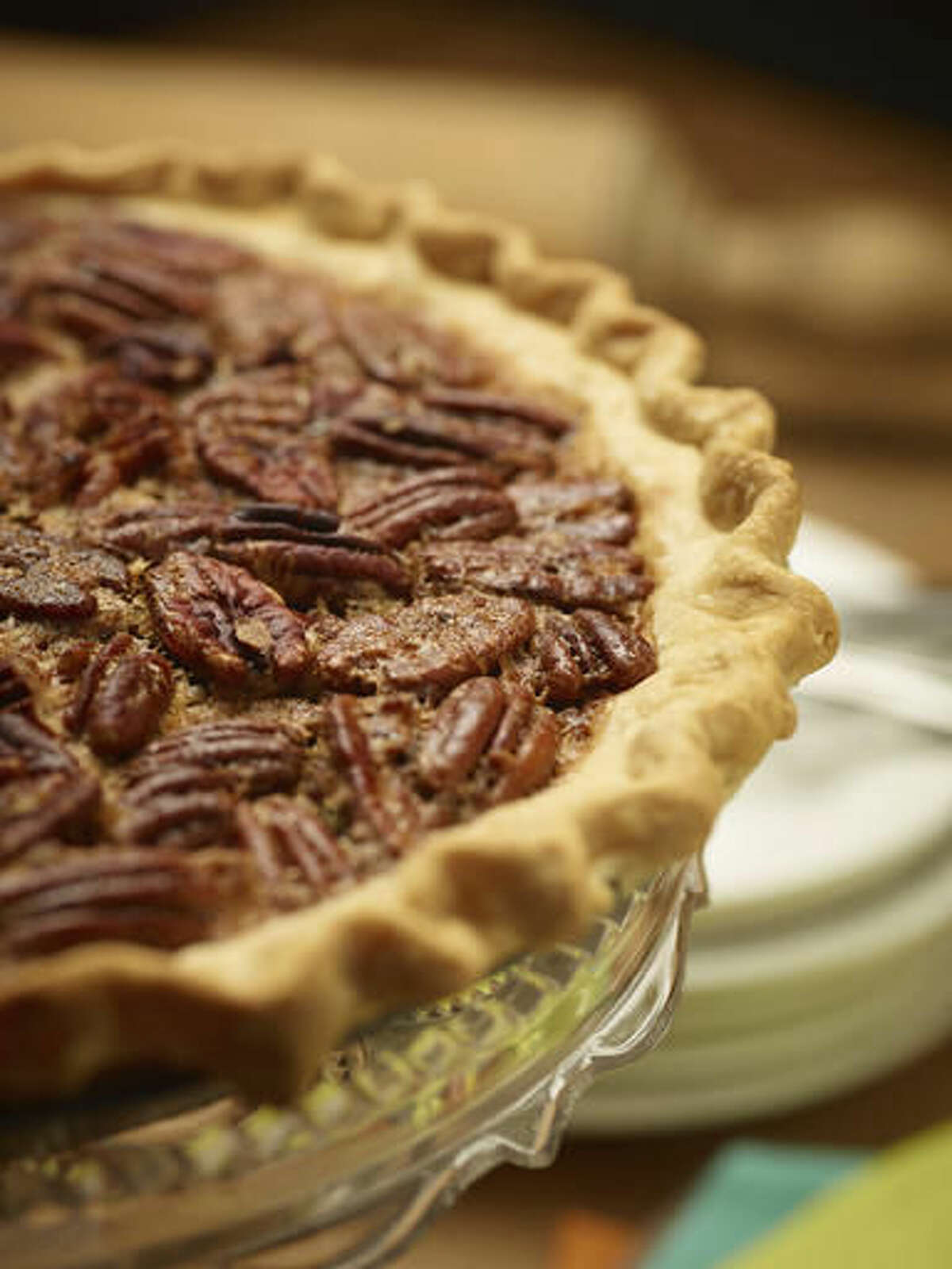 This Oct. 14, 2016 photo provided by The Culinary Institute of America shows pecan pie in Hyde Park, N.Y. This dish is from a recipe by the CIA. (Phil Mansfield/The Culinary Institute of America via AP)