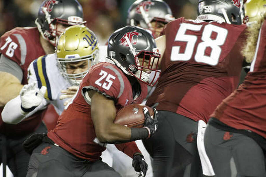 FILE - In this Oct. 15, 2016, file photo, Washington State running back Jamal Morrow (25) carries the ball during the second half of an NCAA college football game against UCLA in Pullman, Wash. WSU has a five-game winning streak going, they're undefeated in Pac-12 play and they've very nearly cracked the national rankings. And yet, they're wary of playing Oregon State on Saturday. (AP Photo/Young Kwak, File)