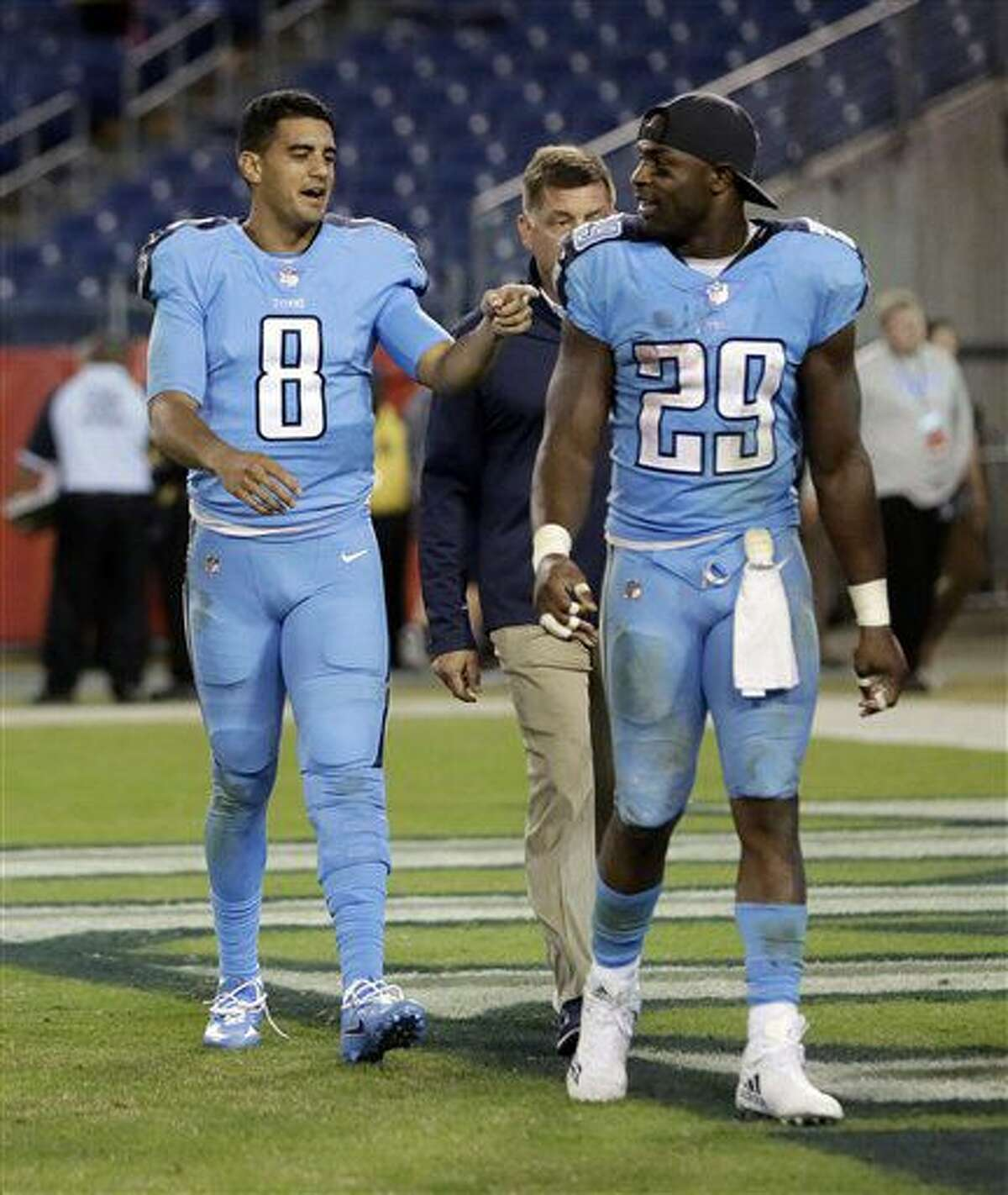 Tennessee Titans quarterback Marcus Mariota (8) talks with running back DeMarco Murray (29) after an NFL football game between the Titans and the Jacksonville Jaguars Thursday, Oct. 27, 2016, in Nashville, Tenn. The Titans won 36-22. (AP Photo/James Kenney)