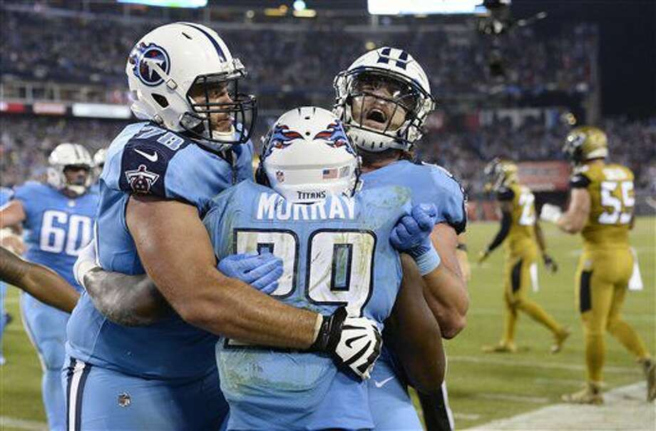 Tennessee Titans running back DeMarco Murray (29) celebrates with offensive tackle Jack Conklin (78) and tight end Phillip Supernaw, right, after Murray scored a touchdown on a 14-yard run against the Jacksonville Jaguars in the first half of an NFL football game Thursday, Oct. 27, 2016, in Nashville, Tenn. (AP Photo/Mark Zaleski)