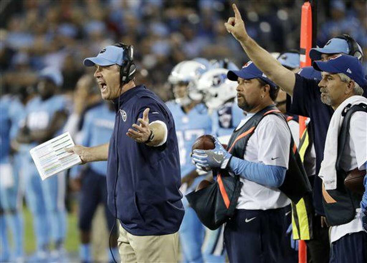 Tennessee Titans head coach Mike Mularkey, left, yells from the sideline in the second half of an NFL football game against the Jacksonville Jaguars Thursday, Oct. 27, 2016, in Nashville, Tenn. (AP Photo/James Kenney)