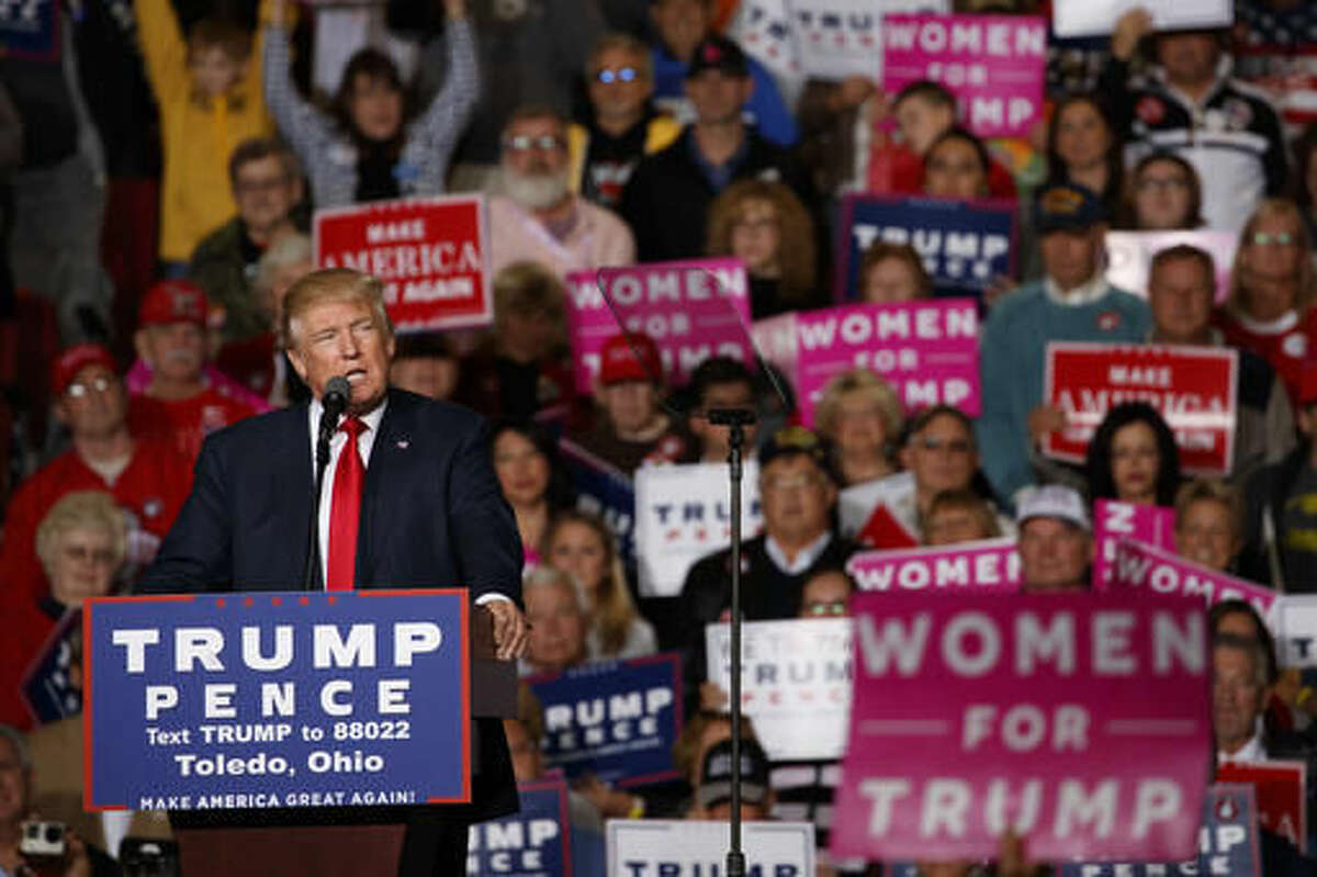 FILE - In this Oct. 27, 2016 file photo, Republican presidential candidate Donald Trump speaks during a campaign rally in Toledo, Ohio. AP-GfK poll shows most Americans are upset by Trump's comments about women and believe the accusations made by several women that he kissed and grouped them without their consent. Trump is far behind Clinton among female voters. (AP Photo/ Evan Vucci, File)