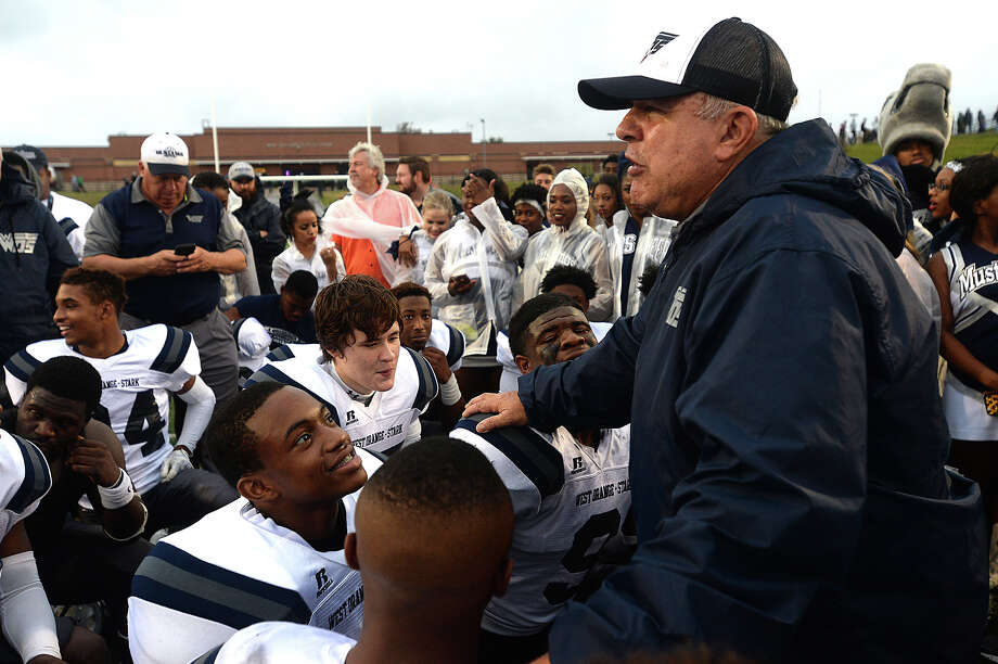 West Orange-Stark Mustangs huddle and get words of congratulations and encouragement for the finals round to come from coach Cornel Thompson after defeating Cuero in Saturday's state semifinal match-up at Darrell Tully Stadium in Houston.