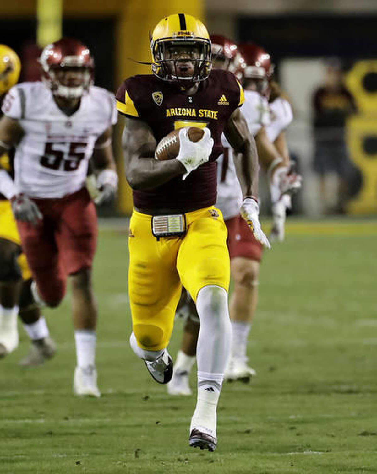FILE - In this Oct. 22, 2016, file photo, Arizona State running back Kalen Ballage runs in for a touchdown against Washington State during the first half of an NCAA college football game in Tempe, Ariz. Arizona State plays Oregon, who has a five game losing streak going, in Eugene, Ore., on Saturday. (AP Photo/Matt York, File)