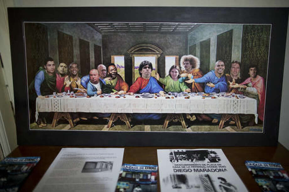 A depiction of the Last Supper, featuring soccer stars like Diego Armando Maradona, center, hangs inside the recently home-turned-museum where Maradona grew up in Buenos Aires, Argentina, Thursday, Oct. 27, 2016. From left are Cristiano Ronaldo, Juan Roman Riquelme, Ronaldino, Julio Grondona, Joao Havelange, Pele, Diego Armando Maradona, Lionel Messi, Carlos Valderrama, Ronaldo, Lothar Matthaus and Enzo Francescoli. (AP Photo/Natacha Pisarenko)