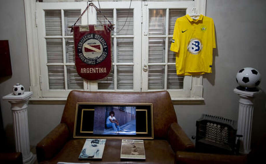 Items that belonged to soccer legend Diego Armando Maradona are displayed inside his old home in Buenos Aires, Argentina, Thursday, Oct. 27, 2016. The home where Maradona lived as a teenager while playing for Argentinos Juniors recently opened to the public, becoming a new shrine for the soccer legend. (AP Photo/Natacha Pisarenko)