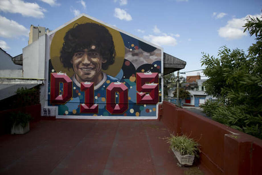 A mural decorates the terrace of soccer legend Diego Armando Maradona's home-turned-museum in Buenos Aires, Argentina, Thursday, Oct. 27, 2016. The home where Maradona lived as a teenager while playing for Argentinos Juniors recently opened to the public, becoming a new shrine for the soccer legend. The mural was painted by artist El Marian. (AP Photo/Natacha Pisarenko)