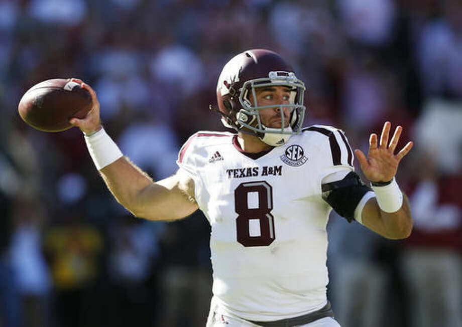 Texas A&M quarterback Trevor Knight sets back to pass during the first half of an NCAA college football game against Alabama, Saturday, Oct. 22, 2016, in Tuscaloosa, Ala. (AP Photo/Brynn Anderson)