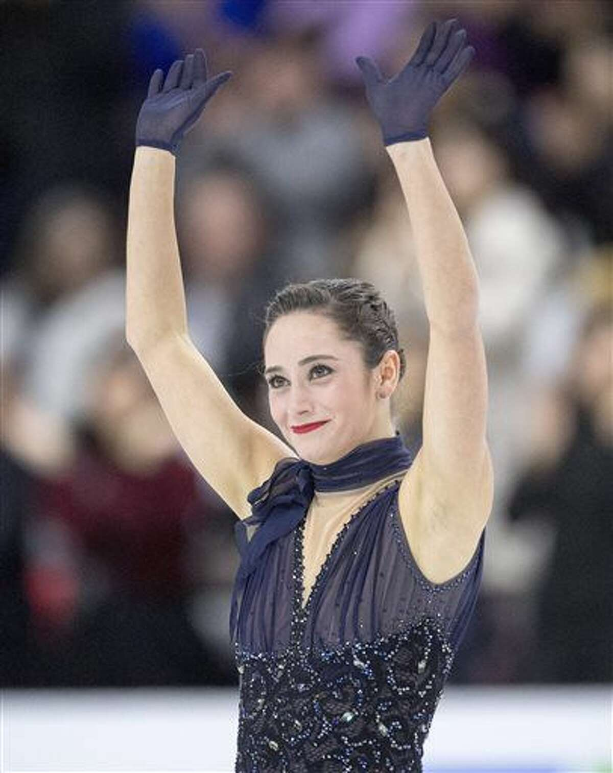 Canada's Kaetlyn Osmond waves to the crowd after skating in the ladies short program at Skate Canada International figure skating event, Friday, Oct. 28, 2016 in Mississauga, Ontario. (Frank Gunn/The Canadian Press via AP)