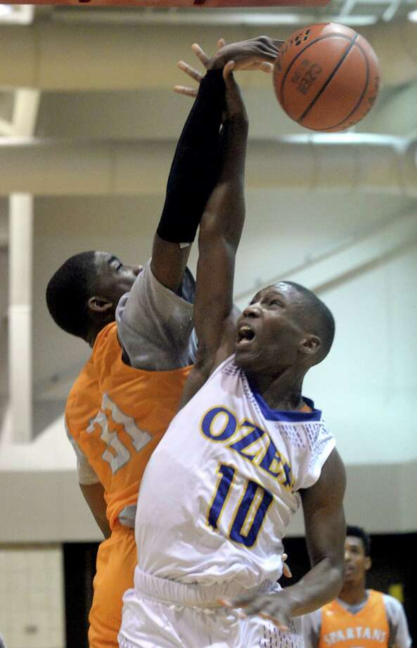 Ozen's Courtland Pender puts up a shot against the pressure of Scarborough's Lydarius Jackson during Thursday's match-up on the opening day of the annual YMBL tournament, which continues through Saturday at venues on the Lamar University campus. Photo taken Thursday, December 1, 2016 Kim Brent/The Enterprise Photo: Kim Brent / Beaumont Enterprise