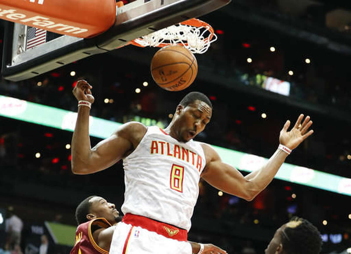 FILE - In this Oct. 10, 2016, file photo, Atlanta Hawks center Dwight Howard (8) scores against the Cleveland Cavaliers in the first half of an exhibition NBA basketball game in Atlanta. One of the most intriguing storylines of the NBA season could be in Atlanta, where Howard and the Hawks are hoping they'll be just what the other needs to recapture what they once had. (AP Photo/John Bazemore, File)