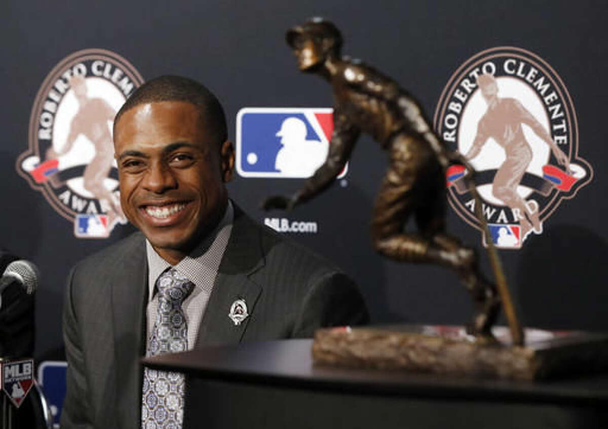 New York Mets' Curtis Granderson smiles at a news conference as he receives the 2016 MLB Roberto Clemente Award before Game 3 of the Major League Baseball World Series Friday, Oct. 28, 2016, in Chicago. (AP Photo/Charles Rex Arbogast)