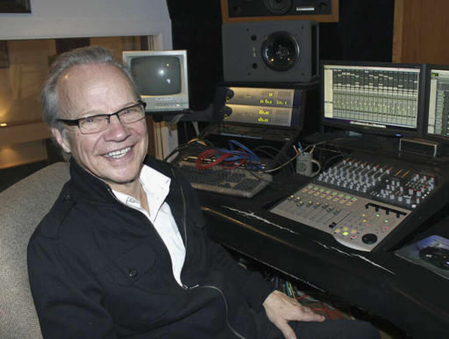 FILE - In this Dec. 18, 2013 file photo, Bobby Vee poses at the studio console at his family's Rockhouse Productions in St. Joseph, Minn. Vee, whose rise toward stardom began as a 15-year-old fill-in for Buddy Holly after Holly was killed in a plane crash, died Monday Oct. 24, 2016 of complications from Alzheimer's disease. He was 73. (AP Photo/Jeff Baenen, File)